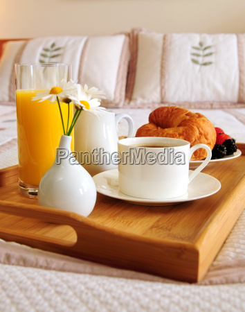 breakfast on a bed in a