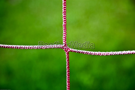 closeup of red soccer net string
