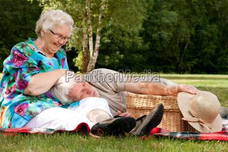 grandmother is tickling grandfather