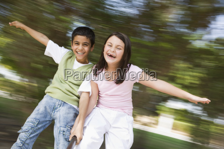 two young children outdoors in playground