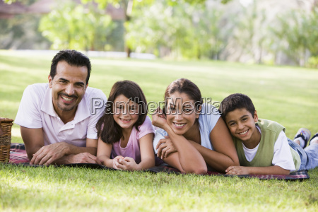 family outdoors in park with picnic