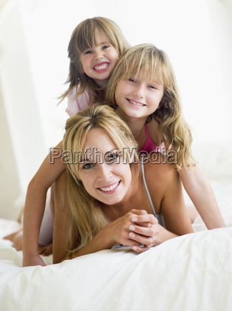 woman and two young girls in