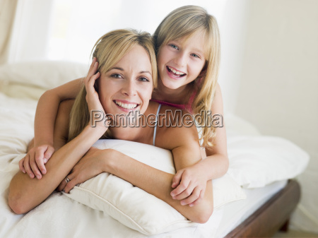 woman and young girl lying in