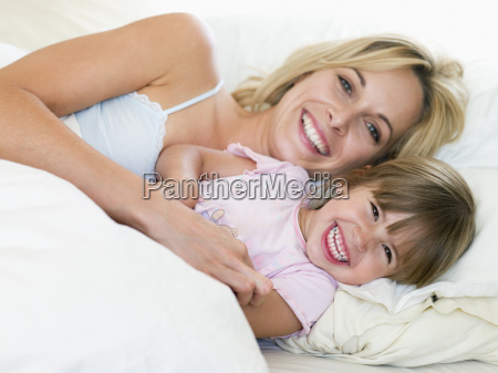 woman and young girl in bed