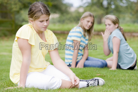 two young girls bullying other young