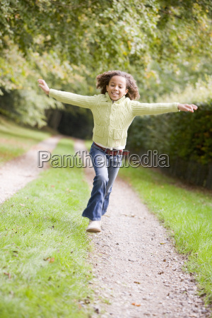young girl running on a path
