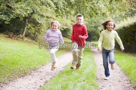 three young friends running on a