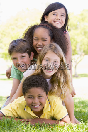 five young friends piled up on