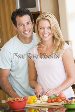 husband and wife preparing mealmealtime together