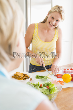 woman talking to friend while preparing