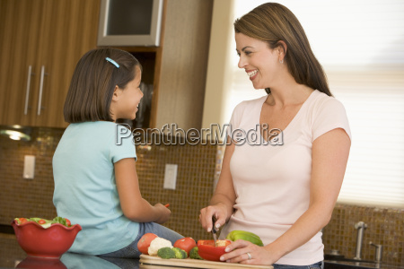 mother and daughter preparing mealmealtime together