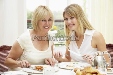 two women enjoying hotel breakfast