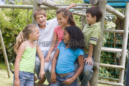 five young friends at a playground