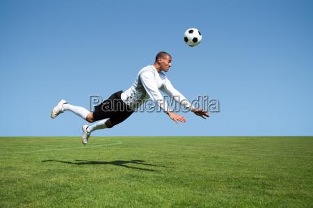 head shot soccer jump