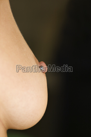 breast with piercing