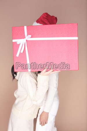 couple hidden by gift box