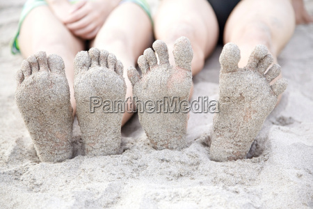 foot of couple on a beach