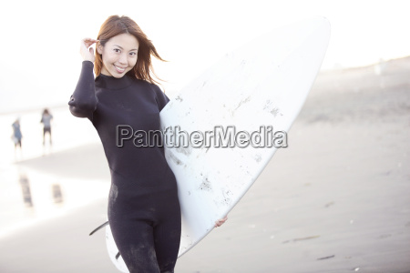 japanese surfer in enoshima beach