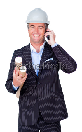 smiling businessman on phone and holding