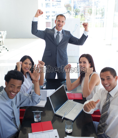 business team in a meeting celebrating