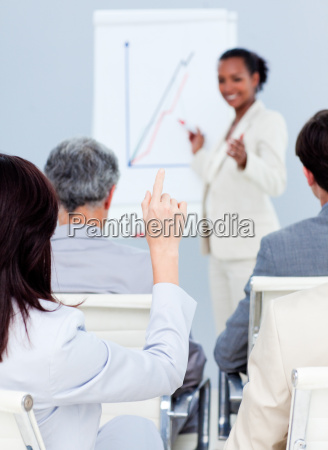 young businesswoman asking a question at