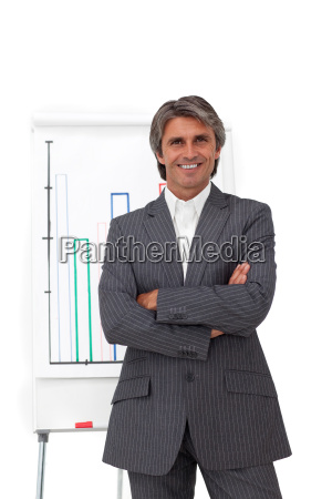 charismatic mature businessman with folded arms