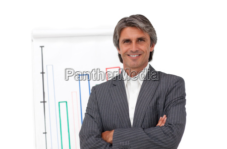 smiling mature businessman in front of