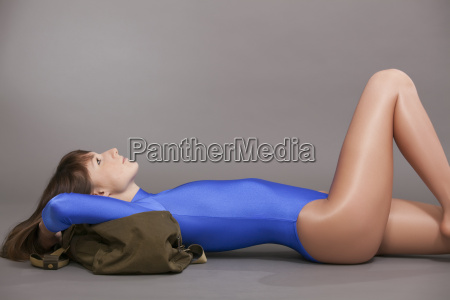 woman in leotard relaxing on the