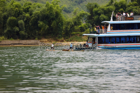 tour boat in a river xingping