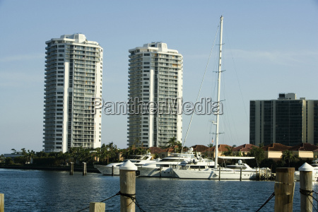 yachts moored at a dock miami