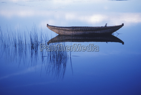 reflection of a boat in a