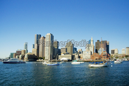 passenger ship and boats in a