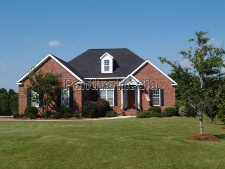 two story brick and stone home