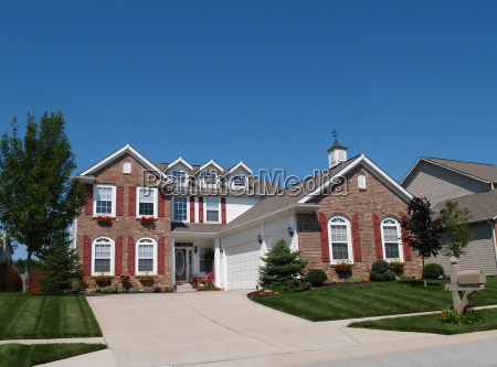 two story home with flowerboxes and