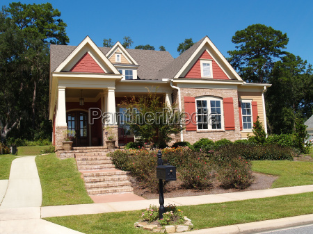 brick home with porch and gables