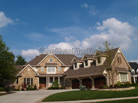 large two story stone and brick