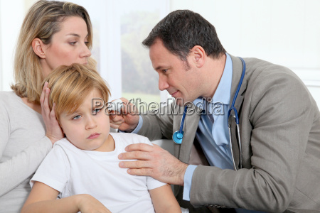 doctor cheking little boys ear infection