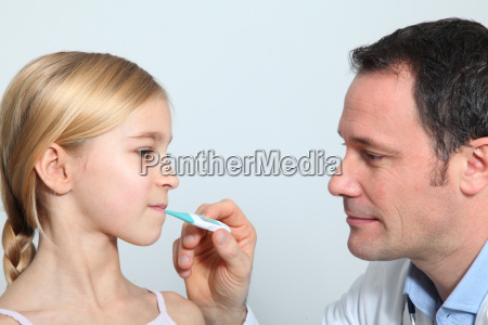 doctor checking little girls temperature