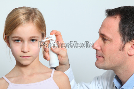 doctor treating little girl ear infection