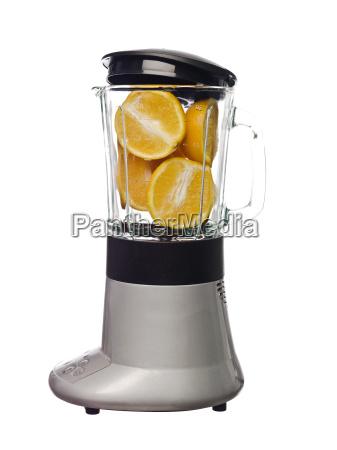blender with oranges