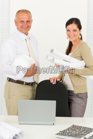 professional architect people behind office table