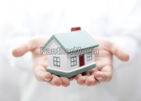 house in hands shallow dof