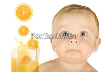 baby boy with orange juice