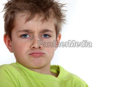 portrait of a pouting boy