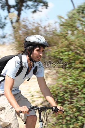 action shot of man riding bike