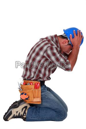 furious craftsman on his knees