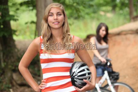 teenage girls riding their bikes