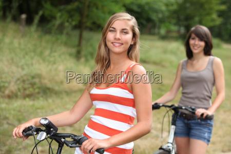 adolescent girls riding their bikes