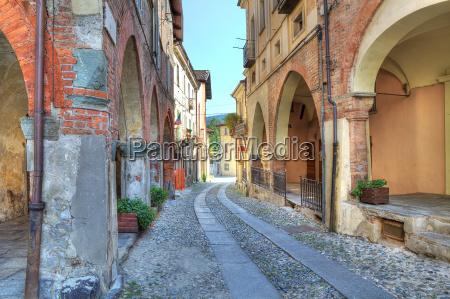 narrow paved street among vintage brick