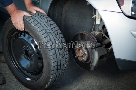 mechanic changing a wheel of a